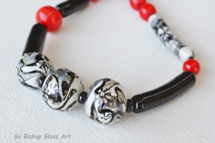 Red, Black and White necklace.. $220